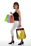 有吸引力的白种人购物微笑的妇女 免版税图库摄影