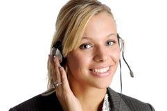 有吸引力的白肤金发的女实业家耳机 免版税库存照片