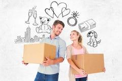 有吸引力的年轻夫妇运载的移动的箱子的综合图象 库存照片