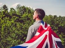 有吸引力,挥动英国旗子的年轻人 图库摄影