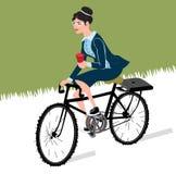 有咖啡乘驾的女商人自行车 城市样式企业在巡洋舰自行车的夫人骑马 皇族释放例证
