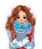 有咖啡杯的逗人喜爱的冬天女孩 库存照片