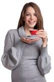 有咖啡的俏丽的微笑的浅黑肤色的男人 免版税库存照片