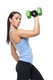 有哑铃的体育妇女 免版税库存图片