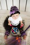 有唐氏综合症的女孩吃糖果的在一个假日helloween 免版税库存照片