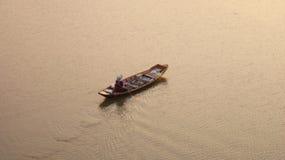 有商人的划艇 免版税库存图片