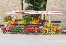 有四个轮子的自行车在正方形 免版税图库摄影
