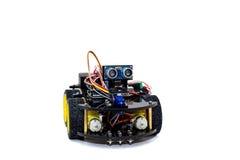 有四只轮子和眼睛的一个机器人 免版税库存图片