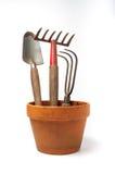 有园艺工具的花盆 免版税图库摄影
