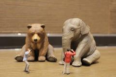 有图的人们塑料动物玩具 图库摄影