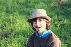 有图画的微笑的男孩在面孔 免版税库存图片
