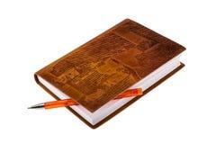 有圆珠笔的皮革笔记本 免版税图库摄影