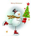有圣诞树的微笑的雪人 图库摄影