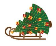 有圣诞树的雪撬 免版税库存照片