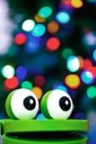 有圣诞灯的青蛙玩具 免版税库存图片