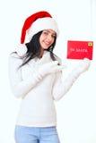 有圣诞老人信件的可爱的妇女女孩 免版税图库摄影