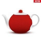 有圣诞老人圣诞节帽子的陶瓷茶壶  库存图片