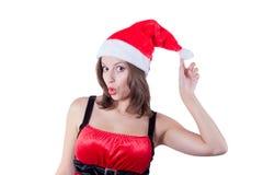 有圣诞老人帽子接触的微笑的美丽的女孩 免版税库存图片