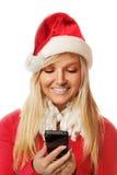 有圣诞老人帽子的妇女 免版税库存照片