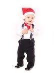 有圣诞老人帽子的小男孩 库存照片