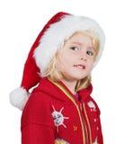 有圣诞老人帽子的愉快的圣诞节小女孩 图库摄影
