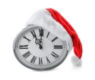 有圣诞老人帽子的时钟在白色背景 christmas countdown 库存照片