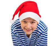 有圣诞老人帽子的男孩少年 免版税库存图片