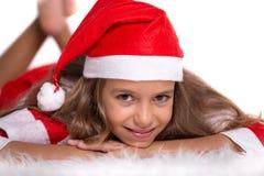 有圣诞老人成套装备的逗人喜爱的女孩 库存照片