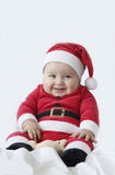 有圣诞老人服装的婴孩 免版税图库摄影