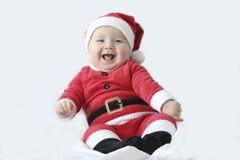 有圣诞老人服装的婴孩 免版税库存图片