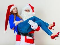 有圣诞老人的可爱的夫人 免版税库存照片