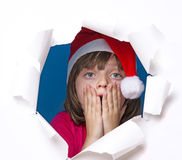 有圣诞老人盖帽的小女孩 库存照片