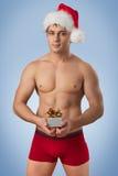 有圣诞老人盖帽的英俊的人 图库摄影
