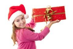 有圣诞老人s帽子的逗人喜爱的小女孩 免版税库存照片