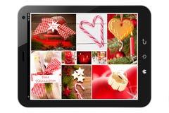 有圣诞节图片的片剂个人计算机 库存照片