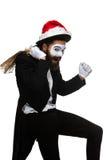 有圣诞节帽子和一件礼物的人在他们的手上 免版税库存照片