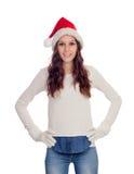有圣诞节帽子的可爱的偶然女孩 图库摄影