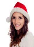 有圣诞节帽子的可爱的偶然女孩 库存图片