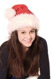 有圣诞节帽子的女孩 免版税图库摄影