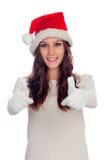 有圣诞节帽子的说可爱的偶然的女孩好 库存图片