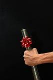 有圣诞节弓的大螺栓 库存照片
