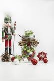 有圣诞节标志的传统胡桃钳在白色背景 免版税库存图片