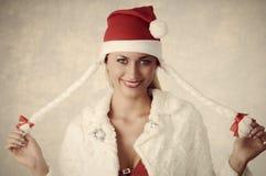有圣诞节样式的微笑的女孩 库存图片