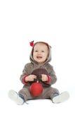 有圣诞节球的微笑的婴孩 库存图片