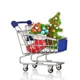 有圣诞节礼物和礼物的购物车 概念 免版税库存图片