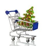 有圣诞节礼物和礼物的购物车 概念 图库摄影
