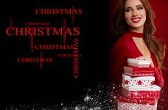 有圣诞节礼物的女孩在红色背景 图库摄影