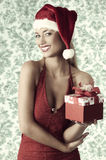 有圣诞节礼物的性感的女孩 免版税图库摄影