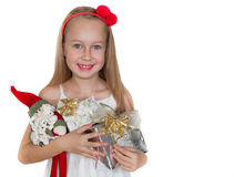 有圣诞节礼物的愉快的小女孩 免版税图库摄影