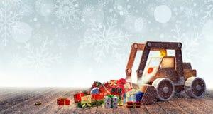 有圣诞节礼物的挖掘机玩具 免版税库存图片